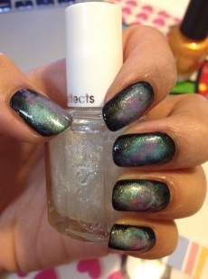 Step 6: This is the most important step to really getting your nails to look like galaxies! For this step, you need a clear nail polish/top coat with micro glitter. I chose this specific one because the glitters aren't bulky, creating a more natural look. However, I've seen other galaxy nail art that takes it a stop further using chunky glitter sparingly, in random areas to create the effect of twinkling stars (after the micro glitter coat). In addition, I've also seen some where they use a tiny dotting tool/toothpick with white nail polish to create stars. I've even seen some stars drawn on with white polish. But I honestly prefer this simpler look I've created, because I wanted the focal point to be solely on the galaxy design, not on the glitters or faux stars.